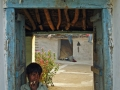Kid-in-doorway-(rural-village)