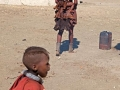 Himba-village-woman-carrying-infant